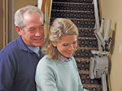 Couple with a home stairlift