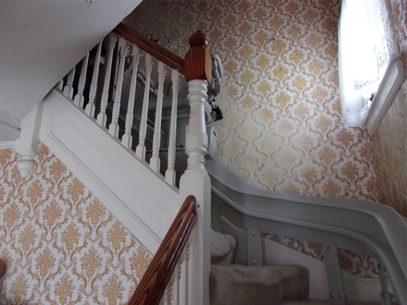 Curved home stairlift rail