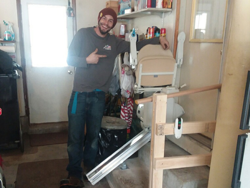 Technician installing a stairlift