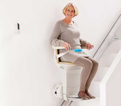Woman riding on a stairlift