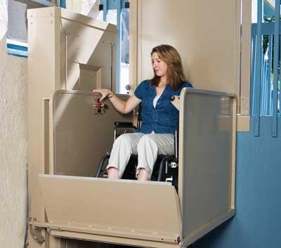 woman using a wheelchair lift